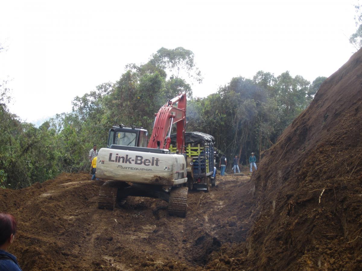 Machine working on landslide