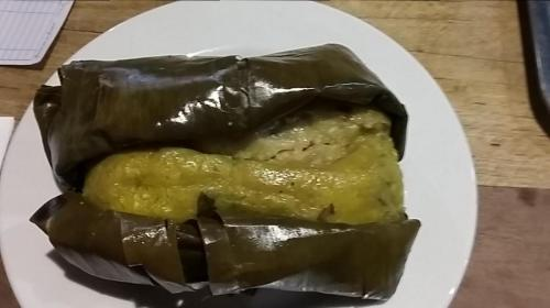 Tamales are in plantain leaves instead of corn husks and have different spices from what we are used to