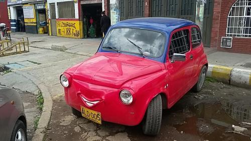 Body of a car has been modified to add a smile. Not sure of the original model