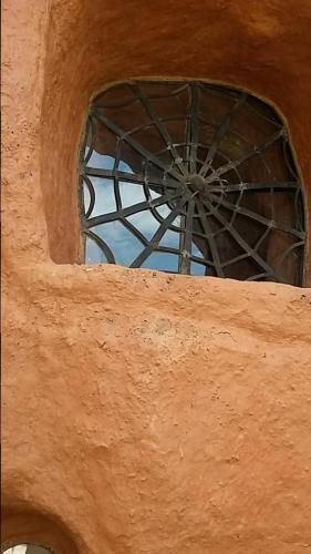 Exterior view Terracotta House window with spider web design