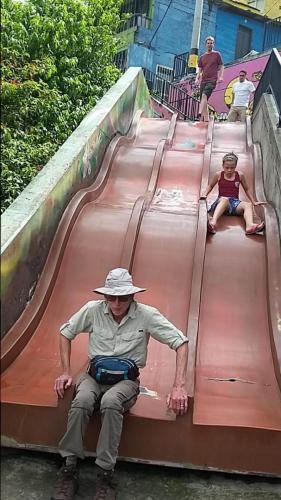 Dan on slide in Comuna 13