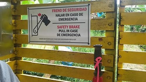 Mixture of English and Spanish on safety brake sign