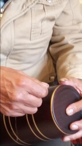 Artist applying mopa mopa
