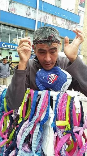 Cloth head bands; vendor is demonstrating one
