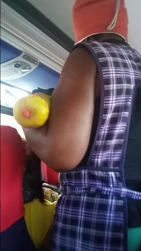 Vendor on bus selling fruit