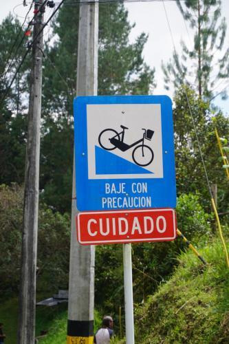 Caution Bike Sign, on a steep hill in Arvi