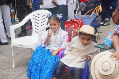 Parade participants, note boy's native costume as well as the girl's
