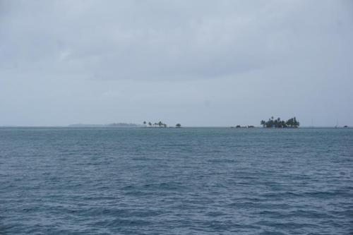 A couple of islands and sailboats.