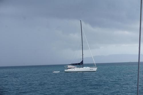 A sailboat; coast of Panama in the background.