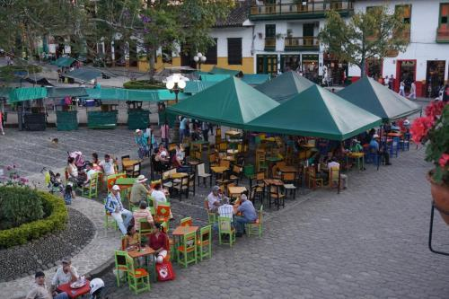 Vibrant plaza with vendors and lots of people
