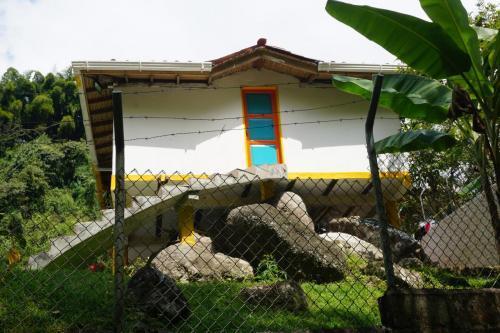 House built around boulders