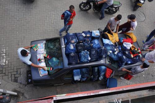 Downtown near Botero Park, Medellin, selling jeans out of a truck