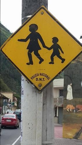 Two children on children in the area sign