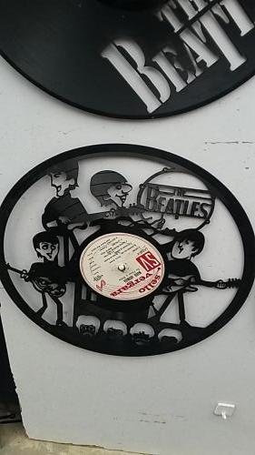 Laser cut LPs with various designs. This one is the Beatles.