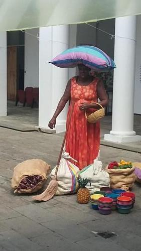 Carrying sack on her head