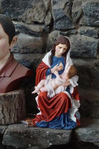 In shop, Mary nursing Baby Jesus