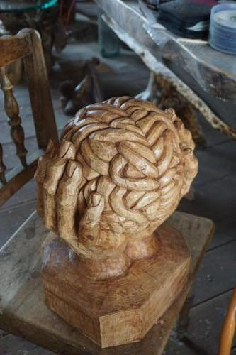Brain held by hands carving in shop