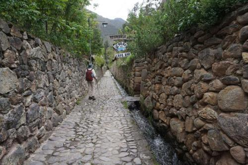 Narrow street with river running along street