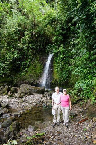 Dan and Lindie in front of waterfall on the way to Volcan