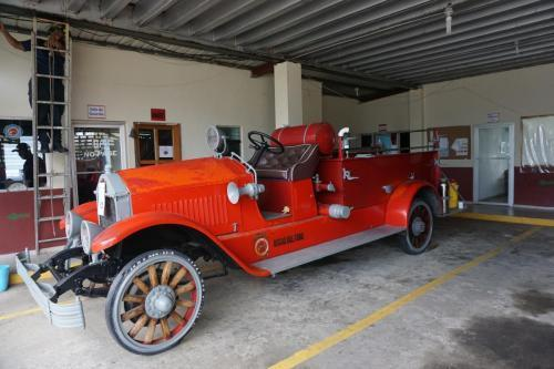 Look closely, I am sitting on the floor of the driver's seat of this old fire truck