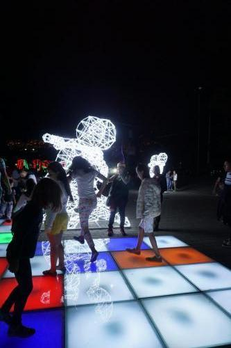 Lights changed colors when children walked on them; light couple dancing in background