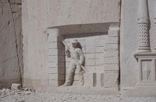 Carving in wall