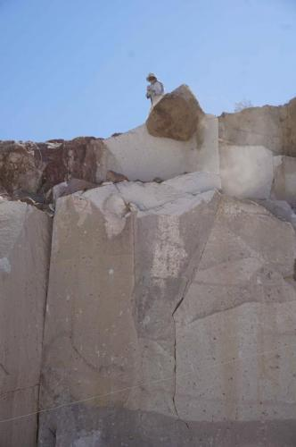 Worker about to dislodge rock